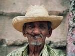 old_wrinkled_man_with_hat_and_cigar-r_200