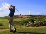 golfer_swinging_with_lighthouse_in_background-r_200